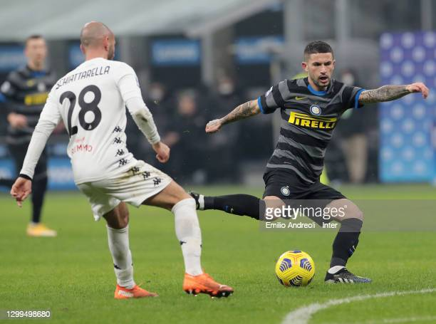 Stefano Sensi of FC Internazionale is challenged by Pasquale Schiattarella of Benevento Calcio during the Serie A match between FC Internazionale and...