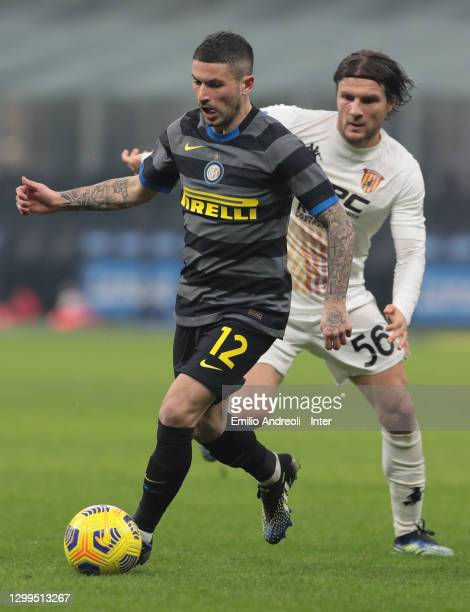 Stefano Sensi of FC Internazionale is challenged by Perparim Hetemaj of Benevento Calcio during the Serie A match between FC Internazionale and...