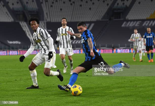 Stefano Sensi of FC Internazionale is closed down by Juan Cuadrado of Juventus during the Coppa Italia semi-final Juventus and FC Internazionale at...