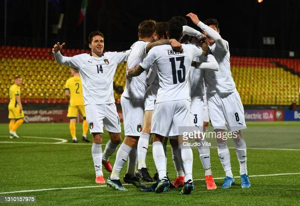 Stefano Sensi of Italy celebrates with team-mates after scoring the opening goal during the FIFA World Cup 2022 Qatar qualifying match between...