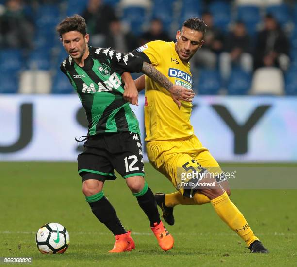 Stefano Sensi of US Sassuolo Calcio competes for the ball with Kadhim Ali Adnan of Udinese Calcio during the Serie A match between US Sassuolo and...