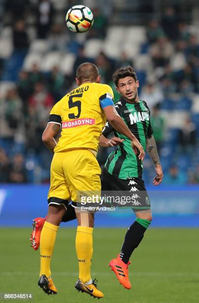 Stefano Sensi of US Sassuolo Calcio jumps for the ball with Larangeira Danilo of Udinese Calcio during the Serie A match between US Sassuolo and...