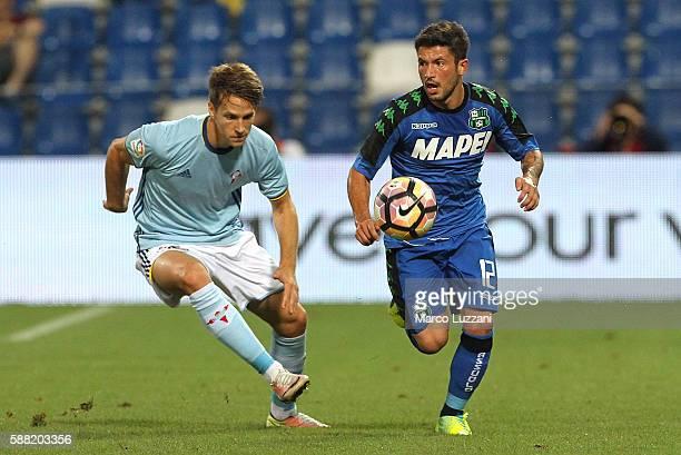 Stefano Sensi of US Sassuolo is challenged by Josep Sene of Celta Vigo during the TIM Preseason Tournament at Mapei Stadium Citta' del Tricolore on...
