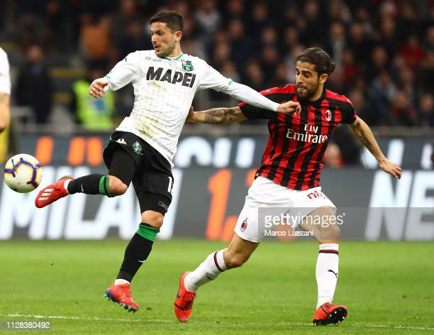 Stefano Sensi of US Sassuolo is challenged by Ricardo Rodriguez of AC Milan during the Serie A match between AC Milan and US Sassuolo at Stadio...