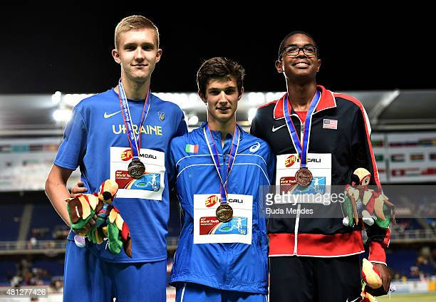 Stefano Sottile of Italy gold medal Dmytro Nikitin of the Ukraine silver medal and Darius Carbin of the USA bronze medal celebrate on the podium...