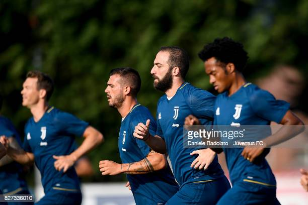 Stefano Sturaro and Gonzalo Higuain of Juventus during a training session on August 7 2017 in Vinovo Italy