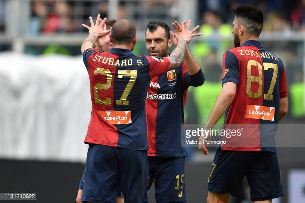 Stefano Sturaro and Goran Pandev of Genoa CFC celebrate victory at the end of the Serie A match between Genoa CFC and Juventus at Stadio Luigi...