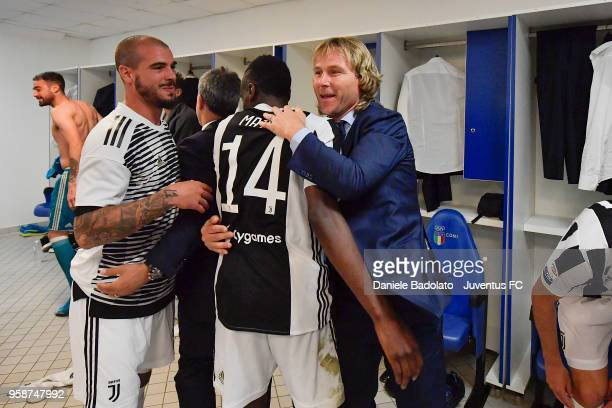 Stefano Sturaro Blaise Matuidi and Pavel Nedved of Juventus in action during the serie A match between AS Roma and Juventus at Stadio Olimpico on May...