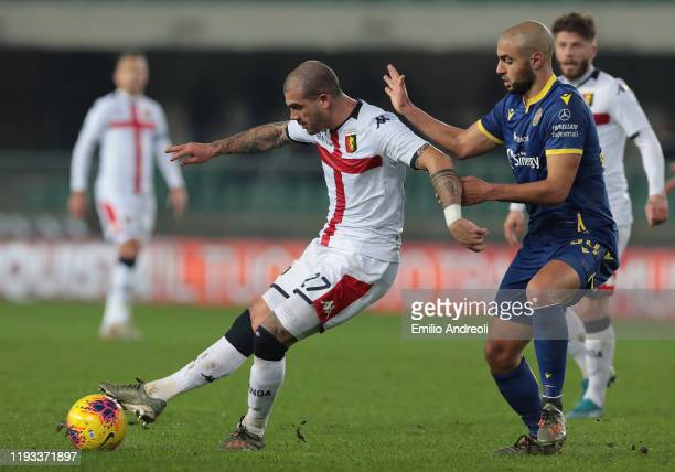 Stefano Sturaro of Genoa CFC is challenged by Sofyan Amrabat of Hellas Verona during the Serie A match between Hellas Verona and Genoa CFC at Stadio...