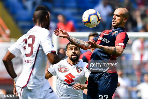 Stefano Sturaro of Genoa challenged by Nicolas NKoulou and Tomas Rincon of Torino during the Serie A match between Genoa CFC and Torino FC at Stadio...