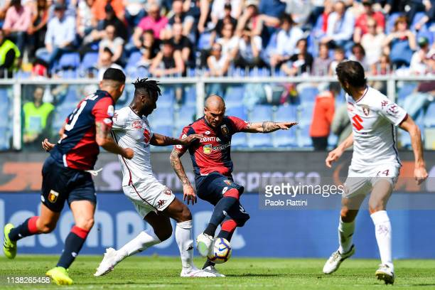 Stefano Sturaro of Genoa gets injured while shooting at goal during the Serie A match between Genoa CFC and Torino FC at Stadio Luigi Ferraris on...