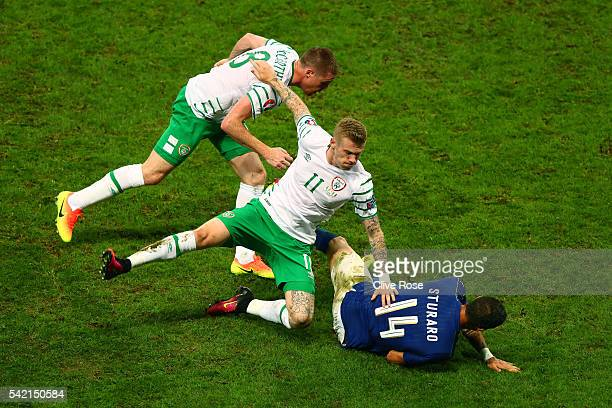 Stefano Sturaro of Italy is challenged by James McClean and James McCarthy of Republic of Ireland during the UEFA EURO 2016 Group E match between...