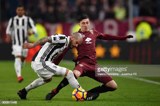 Stefano Sturaro of Juventus and Daniele Baselli of Torino compete for the ball during the TIM Cup match between Juventus and Torino FC at Allianz...