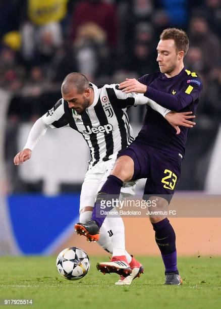 Stefano Sturaro of Juventus competes for the ball with Christian Eriksen of Tottenham Hotspur FC during the UEFA Champions League Round of 16 First...