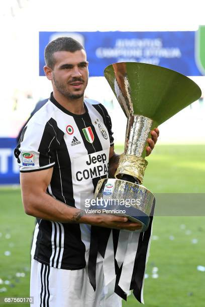 Stefano Sturaro of Juventus FC celebrates with the trophy after the beating FC Crotone 3-0 to win the Serie A Championships at the end of the Serie A...
