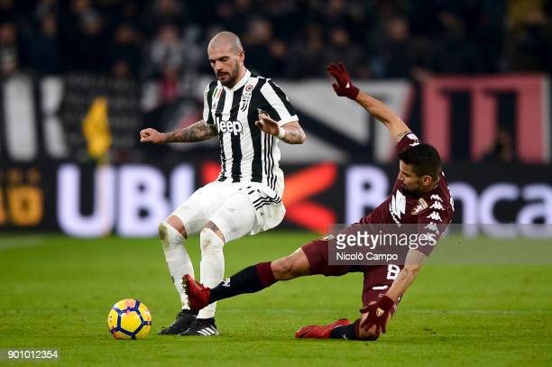 Stefano Sturaro of Juventus FC is tackled by Tomas Rincon of Torino FC during the TIM Cup football match between Juventus FC and Torino FC Juventus...