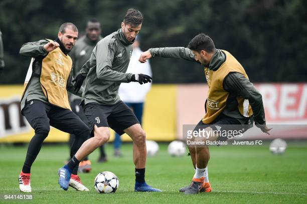 Stefano Sturaro Rodrigo Bentancur and Sami Khedira in action during the Champions League training session at Juventus Center Vinovo on April 10 2018...