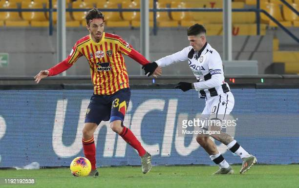 Stefano Tabanelli of Lecce competes for the ball with Rodrigo De Paul of Udinese during the Serie A match between US Lecce and Udinese Calcio at...