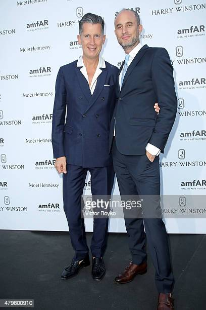 Stefano Tonchi and guest attend the amfAR dinner at the Pavillon LeDoyen during the Paris Fashion Week Haute Couture on July 5 2015 in Paris France