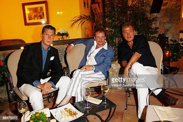 Stefano Tonchi Carlo Ducci Mario Testino attend Il Pellicano Summer Party with Jurgen Teller held at the Hotel Il Pellicano on June 13 2009 in Porto...