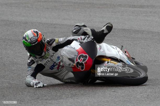 Stefano Valtulini of Italy and Team Imperiali Racing crashed out during the MotoGP of San Marino at Misano World Circuit on September 15 2012 in...