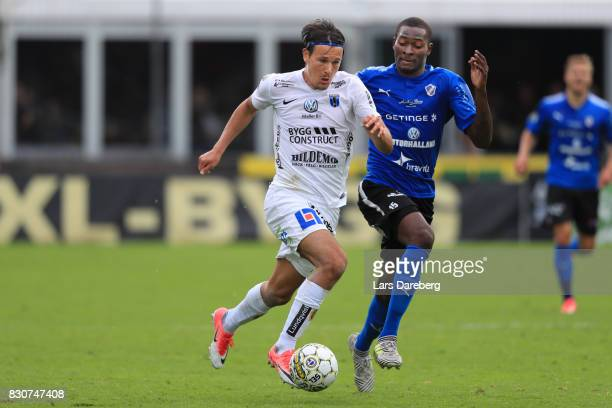 Stefano Vecchia of IK Sirius FK and Aboubakar Keita of Halmstad BK during the Allsvenskan match between Halmstad BK and Sirius FK at Orjans Vall on...