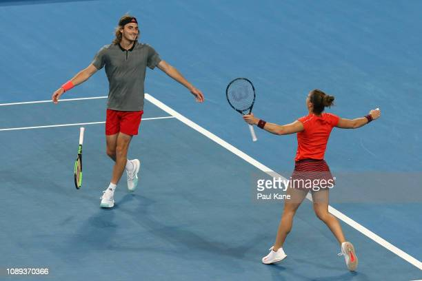 Stefanos Tsitsipas and Maria Sakkari of Greece celebrate winning their mixed doubles match against Roger Federer and Belinda Bencic of Switzerland...