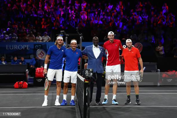 Stefanos Tsitsipas and Roger Federer of Team Europe and John Isner and Jack Sock of Team World pose for a photo with Tidjane Thiam CEO of Credit...