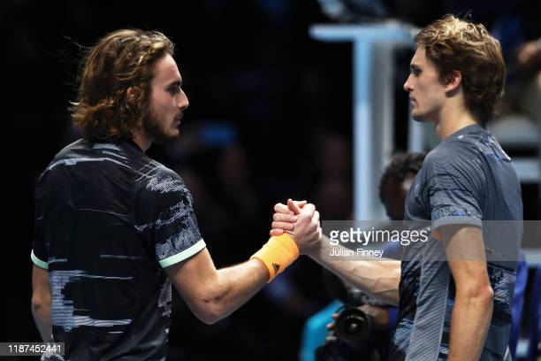 Stefanos Tsitsipas of Greece and Alexander Zverev of Germany shake hands at the net after their singles match during Day Four of the Nitto ATP Finals...