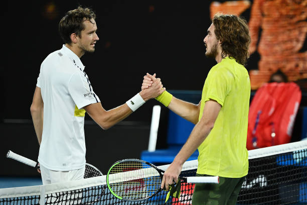 Stefanos Tsitsipas of Greece and Daniil Medvedev of Russia embrace at the net following their Men's Singles Semifinals match during day 12 of the...