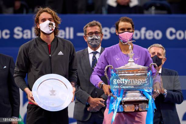 Stefanos Tsitsipas of Greece and Rafael Nadal of Spain pose with their trophies after their final match during day seven of the Barcelona Open Banc...