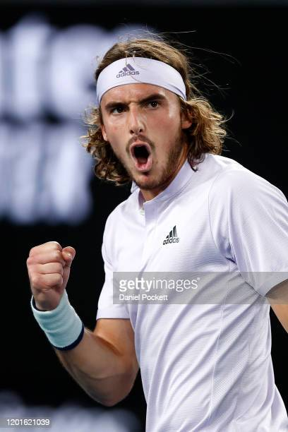 Stefanos Tsitsipas of Greece celebrates after winning a point during his Men's Singles third round match against Milos Raonic of Canada on day five...