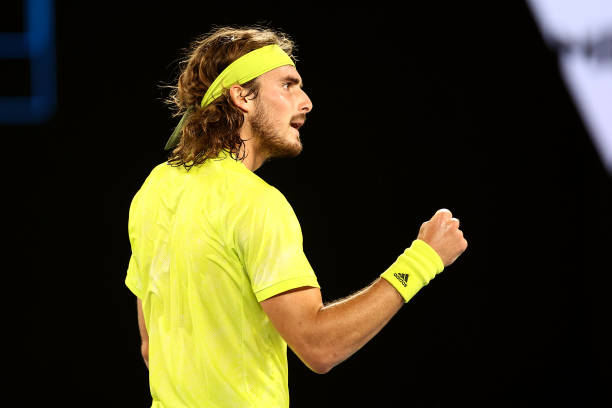 Stefanos Tsitsipas of Greece celebrates after winning a point in his Men's Singles first round match against Gilles Simon of France during day two of...
