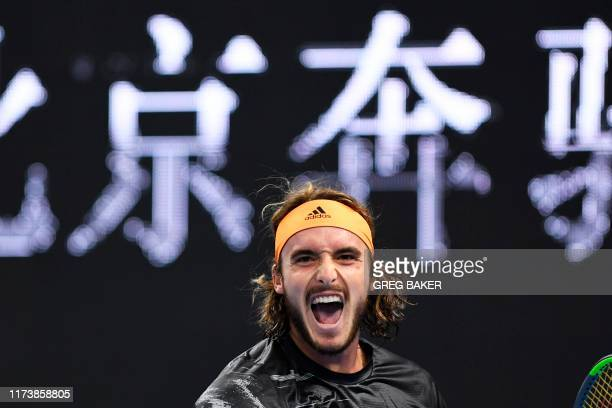 TOPSHOT Stefanos Tsitsipas of Greece celebrates after winning his men's singles semifinal match against Alexander Zverev of Germany at the China Open...