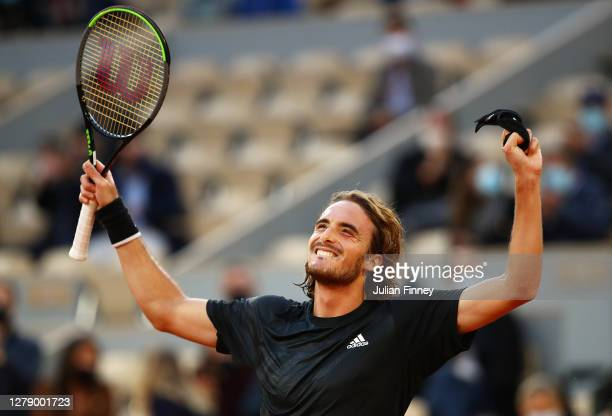 Stefanos Tsitsipas of Greece celebrates after winning match point during his Men's Singles quarterfinals match against Andrey Rublev of Russia on day...
