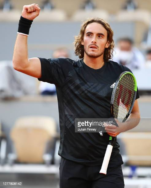 Stefanos Tsitsipas of Greece celebrates his straight sets victory following his Men's Singles second round match against Pablo Cuevas of Uruguay on...