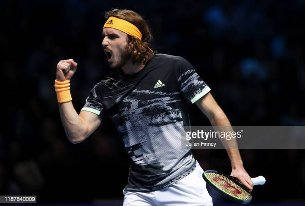 Stefanos Tsitsipas of Greece celebrates in his singles match against Rafael Nadal of Spain during Day Six of the Nitto ATP Finals at The O2 Arena on...