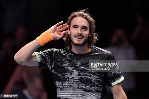 Stefanos Tsitsipas of Greece celebrates victory after his semifinal singles match against Roger Federer of Switzerland during Day Seven of the Nitto...