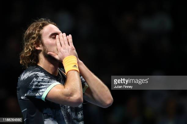 Stefanos Tsitsipas of Greece celebrates victory after his singles final match against Dominic Thiem of Austria during Day Eight of the Nitto ATP...