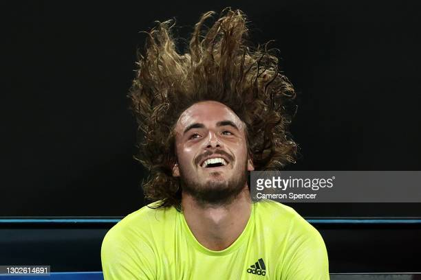 Stefanos Tsitsipas of Greece celebrates victory in his Men's Singles Quarterfinals match against Rafael Nadal of Spain during day 10 of the 2021...