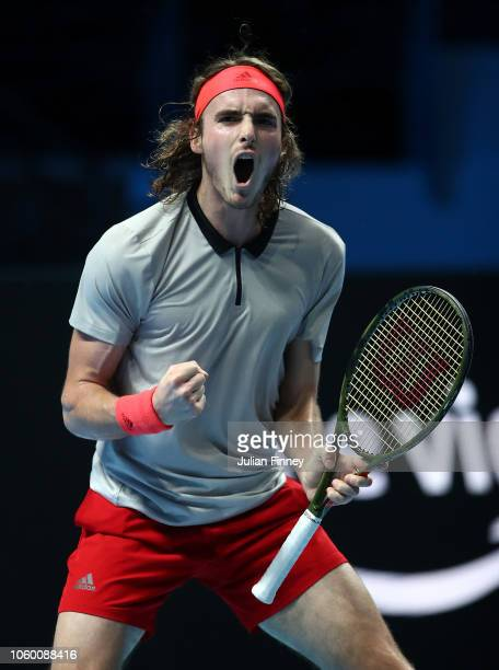 Stefanos Tsitsipas of Greece celebrates winning a game against Alex de Minaur of Australia in the final during Day Five of the Next Gen ATP Finals at...