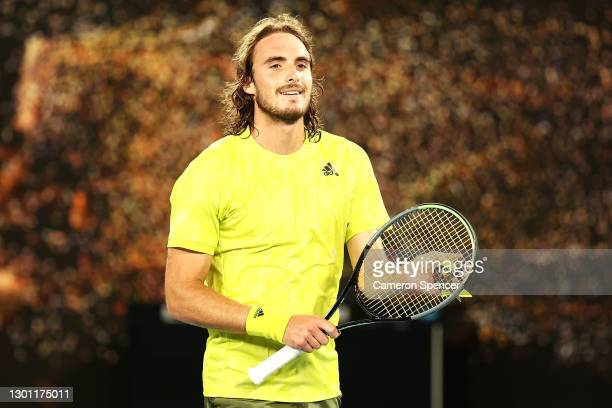 Stefanos Tsitsipas of Greece celebrates winning his Men's Singles first round match against Gilles Simon of France during day two of the 2021...