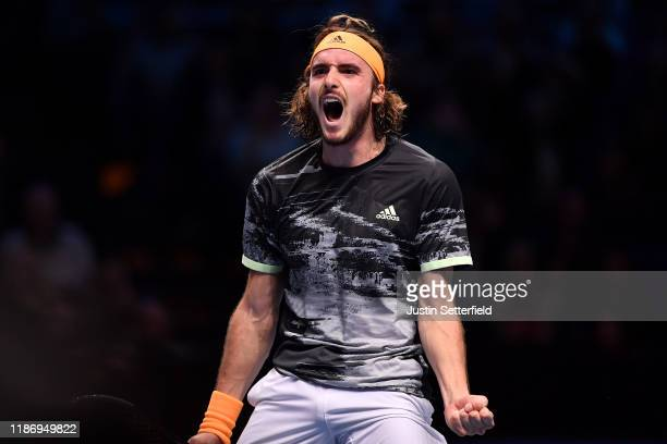 Stefanos Tsitsipas of Greece celebrates winning match point during his singles match against Daniil Medvedev of Russia during during Day 2 of the...