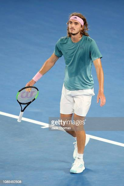 Stefanos Tsitspas of Greece celebrates winning match point in his fourth round match against Roger Federer of Switzerland during day seven of the...