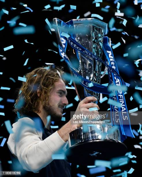 Stefanos Tsitsipas of Greece celebrates with the trophy after his singles final match victory against Dominic Thiem of Austria during Day Eight of...