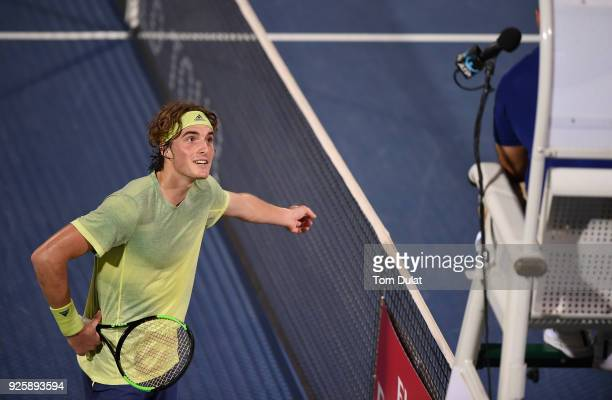 Stefanos Tsitsipas of Greece challenges umpires decision during his quarter final match against Malek Jaziri of Tunisia on day four of the ATP Dubai...
