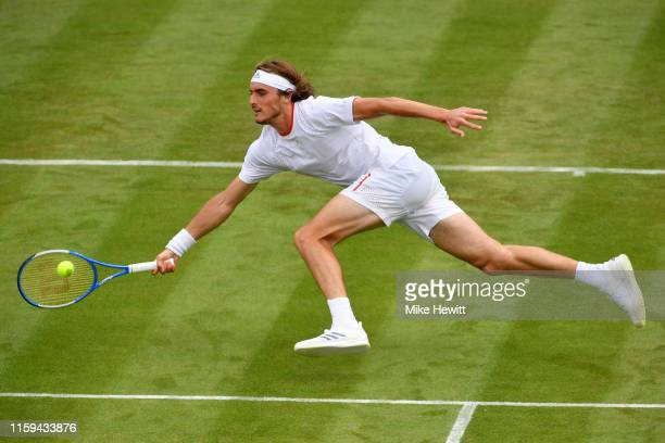 Stefanos Tsitsipas of Greece dives for the ball in his Men's Singles first round match against Thomas Fabbiano of Italy during Day one of The...