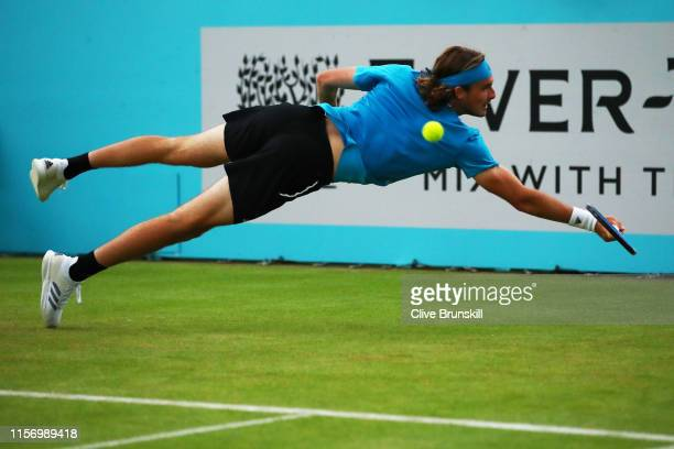 Stefanos Tsitsipas of Greece dives to play a backhand during his First Round Singles Match against Kyle Edmund of Great Britain during day Three of...