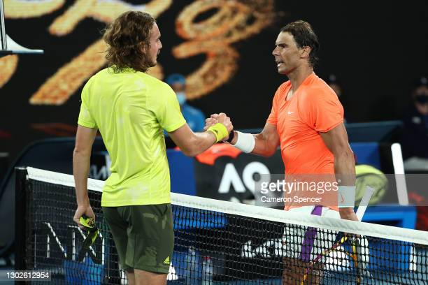 Stefanos Tsitsipas of Greece embraces Rafael Nadal of Spain following victory in his Men's Singles Quarterfinals match during day 10 of the 2021...