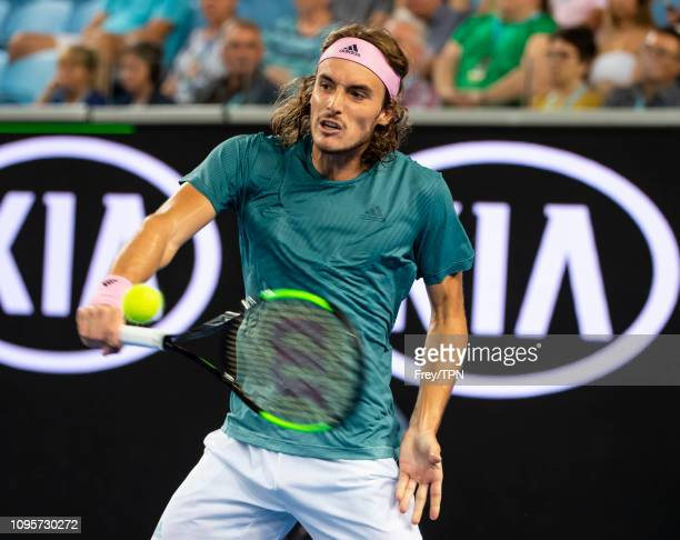 Stefanos Tsitsipas of Greece hits a backhand to Nikoloz Basilashvili of Georgia during day five of the 2019 Australian Open at Melbourne Park on...